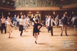 Photo of Ksenia Parkhatskaya teaching swing dancing to big group