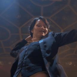 A picture of Ksenia Parkhatskaya swing dancing from underneath