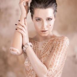 A photo of the artist Ksenia Parkhatskaya white body art