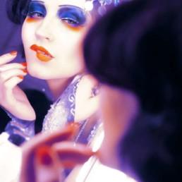 A photo of the artist Ksenia Parkhatskaya orange blue body art