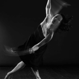 A photo of Ksenia swing dancing in motion