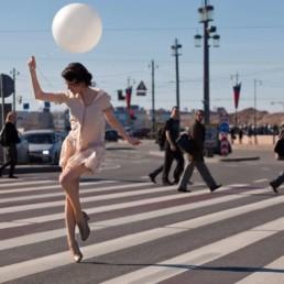 Photo of Ksenia swing dancing on the street colour St Petersburg