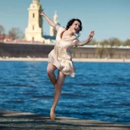 Photo of Ksenia swing dancing outside