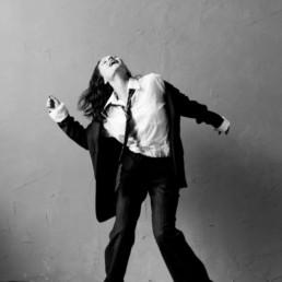Photo of Ksenia swing dancing in black suit head