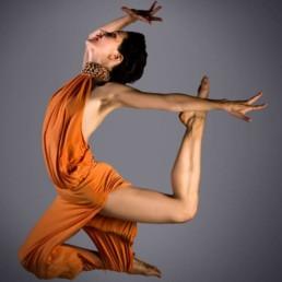 Ksenia Parkhatskaya solo jazz, swing, 20s charleston dancer, choreographer, singer jump in orange dress