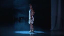 solo jazz and 20s charleston dancer Ksenia Parkhatskaya performing in stage play Radio Hermitage white dress